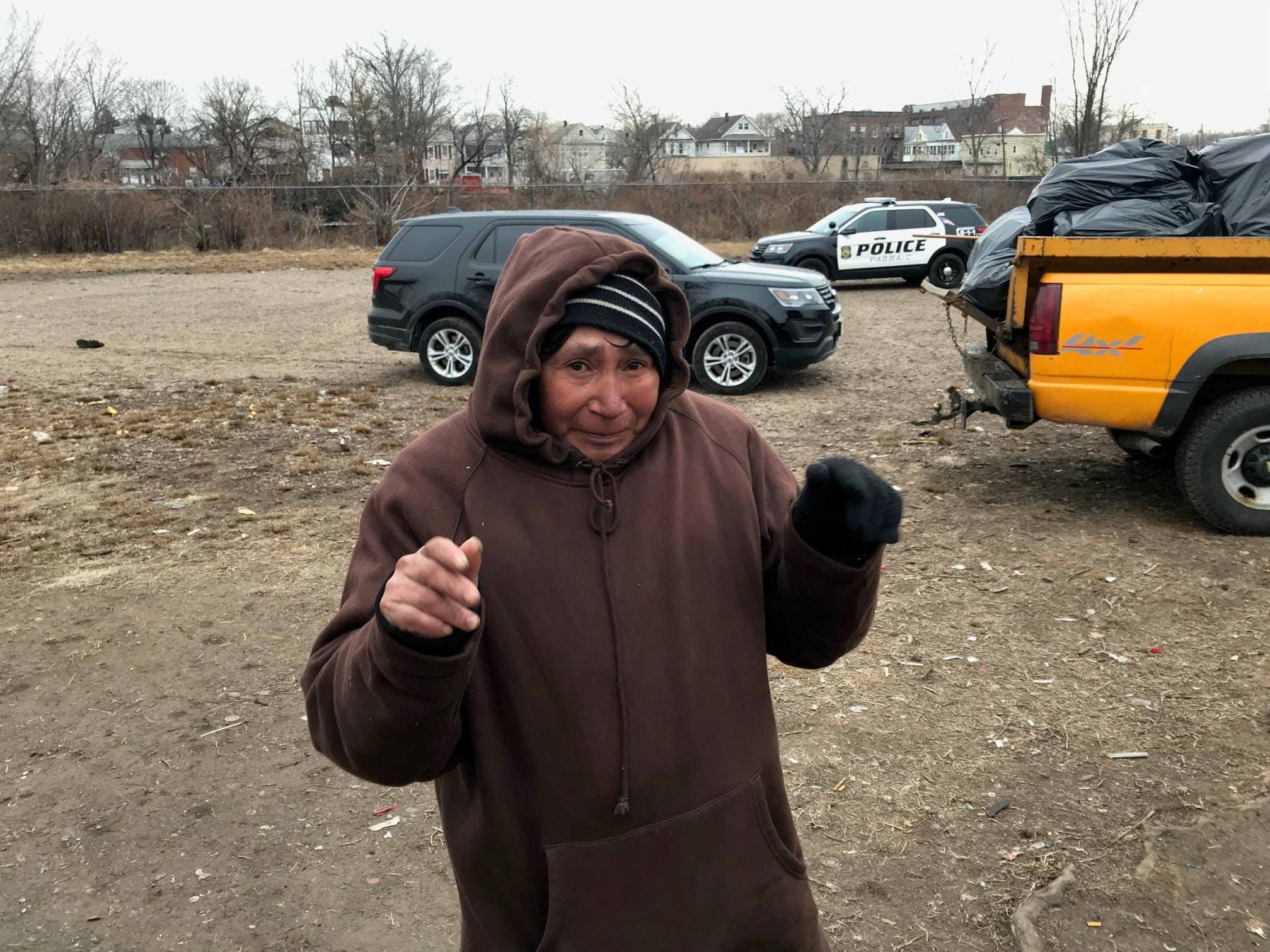 """Salvador Rodriguez, known as """"The Shrimp"""" because of the """"color he turns when he drinks vodka"""" says he is the oldest person living in the homeless encampment on the section of city known as Dundee Island. He says he has a drinking problem which he  hopes to kick on day. Concerning the cold and living outdoors,"""" when talking about his living conditions, broken down and wept """"I'm tired."""""""