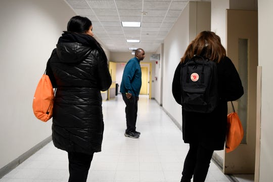Professor Stafford Barton (center), a personal counselor at Bergen Community College, checks in a classroom in the Pitkin Building during the county's annual Point-in-Time count of the homeless on Tuesday, Jan. 23, 2019, in Paramus.