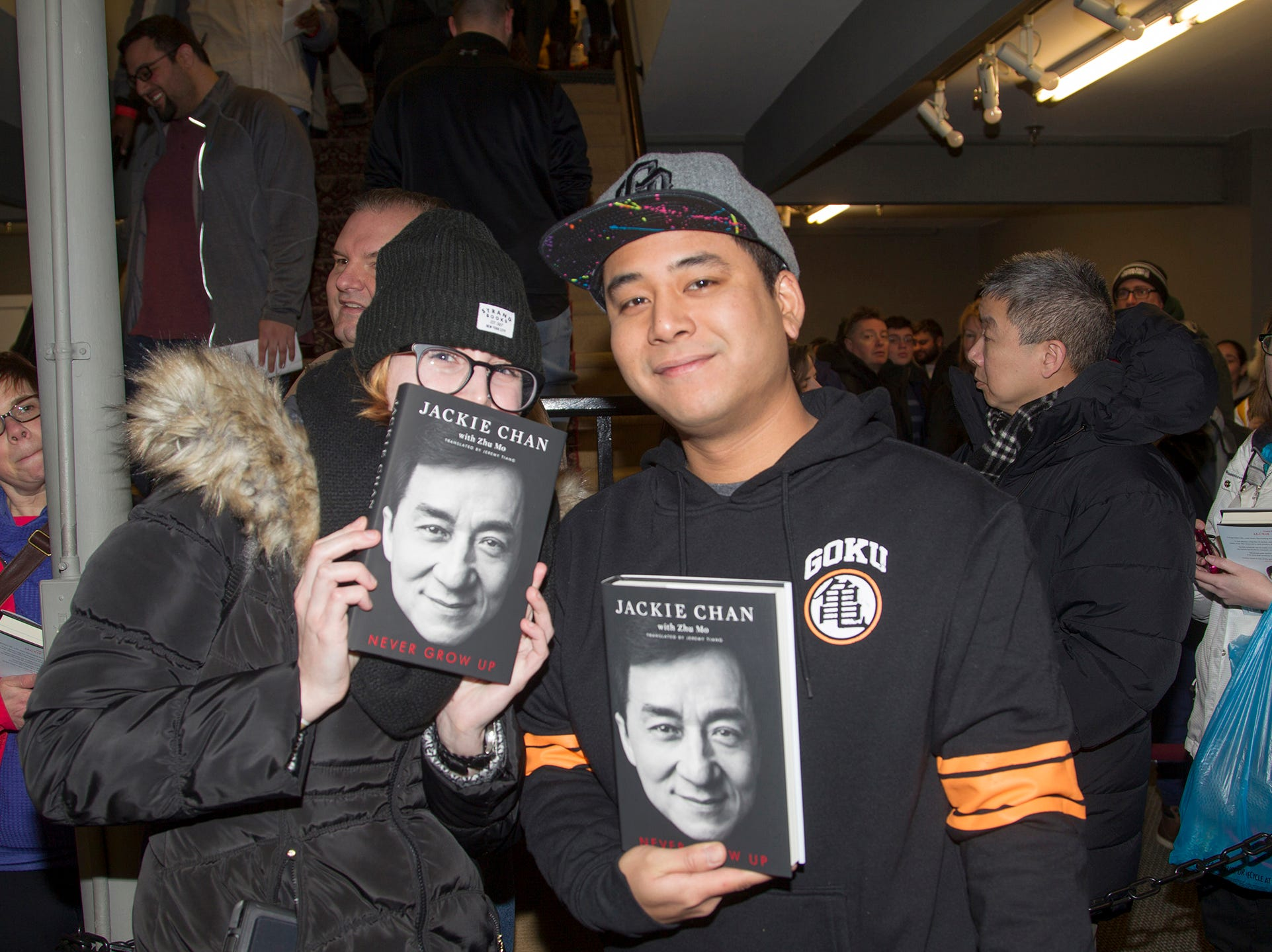 """Lori and Jim. Jackie Chan greets fans at Bookends in Ridgewood while signing his new book, """"Never Grow Up."""" 01/21/2019"""