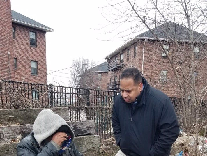 Passaic Mayor Hector Lora talks with Jose Luiz Deleon who has been living on street for lamost a yea. He lost is nearby Fourth Street home after the company he worked for re-located in recent years.  He has been living along railroad tracks by Sixth Street because he is looking for a place where he won't bother anybody.