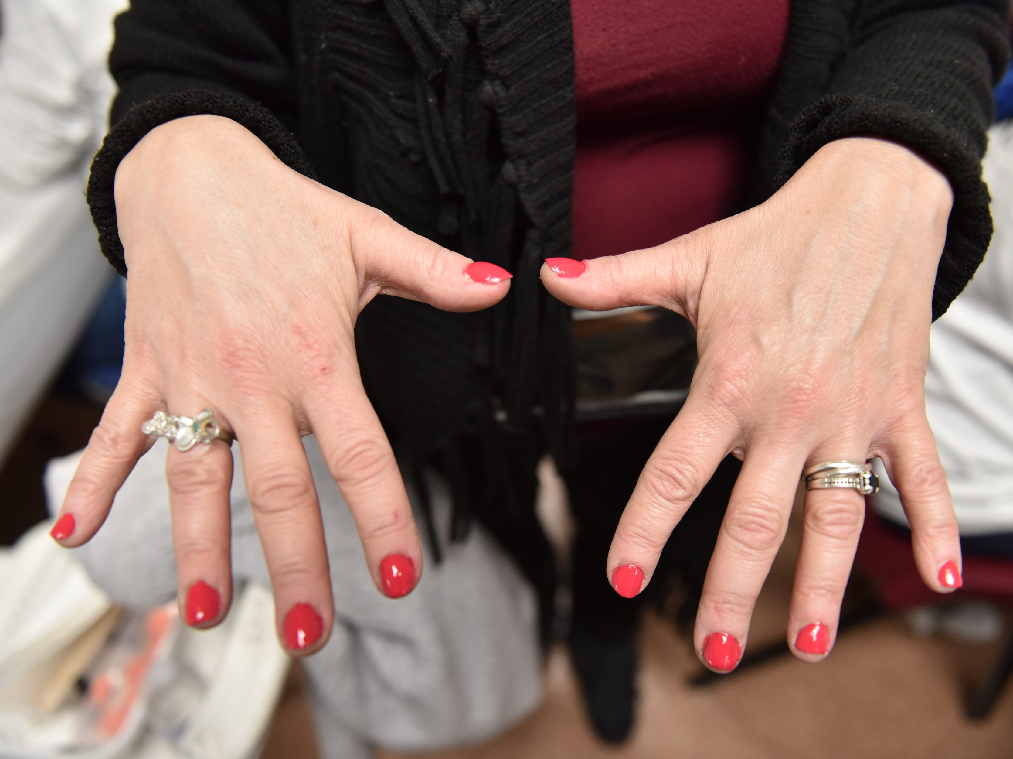 A woman shows off her manicure that was given to her by a student of the Parisian Beauty Academy at the Bergen County Human Services Center in Hackensack, on Wednesday January 23, 2019.