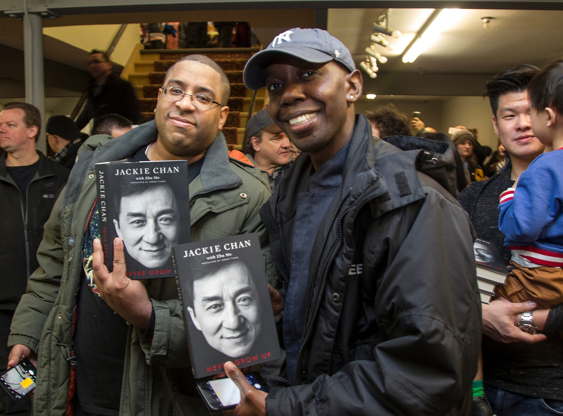 """Kevin and Sean. Jackie Chan greets fans at Bookends in Ridgewood while signing his new book, """"Never Grow Up."""" 01/21/2019"""