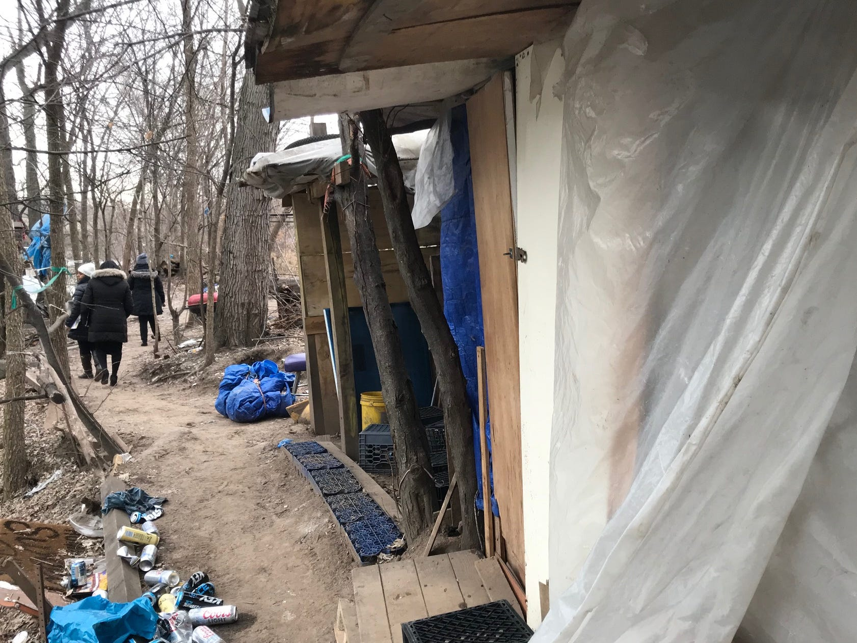 Members of City of  Passaic's Human Services department walk through homeless encampment on Dundee Island Wednesday as they try to get a tally of the number of homeless folk in the city. The tally was northward of 30 people.