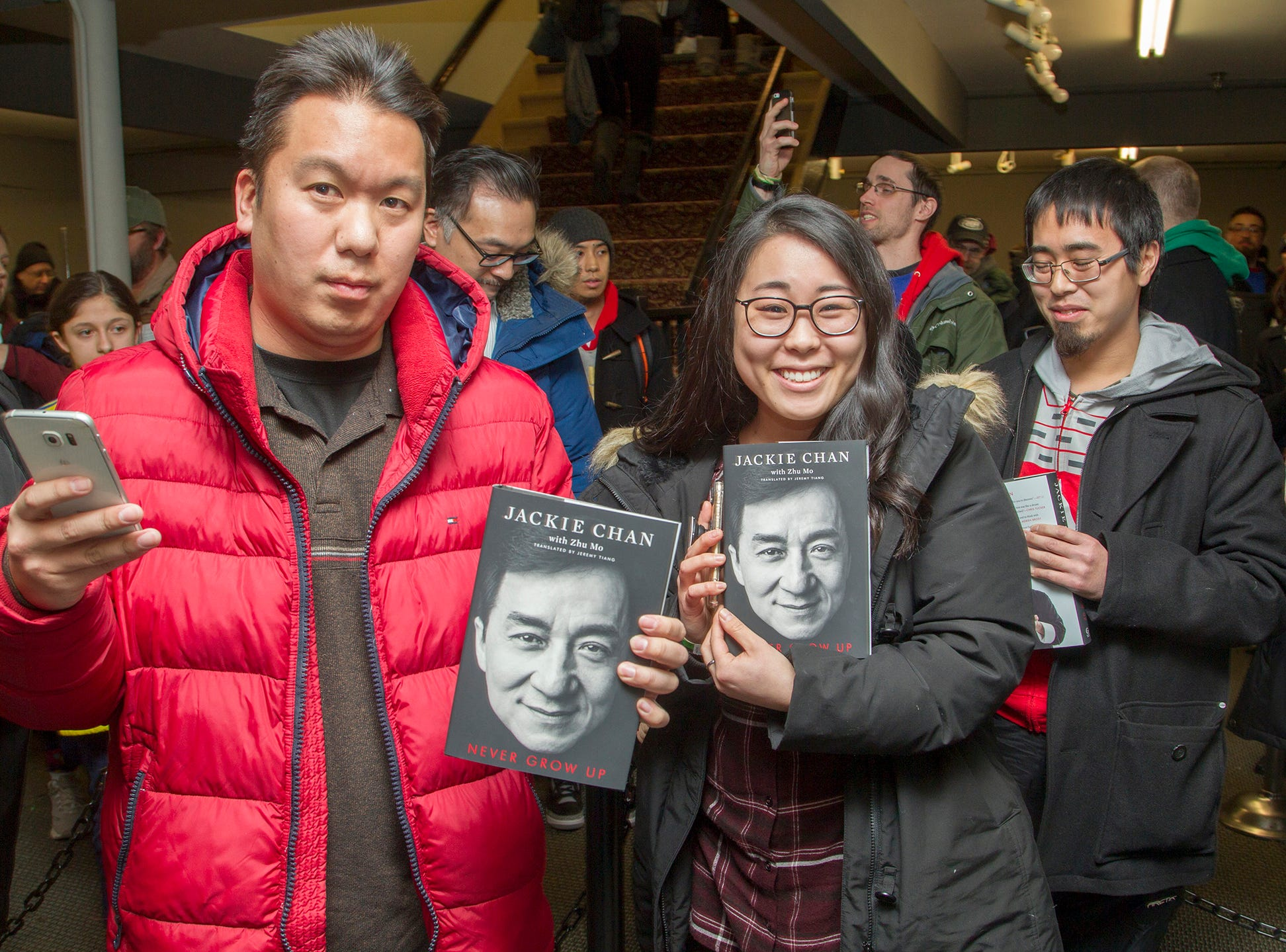 """Calvin and Linda. Jackie Chan greets fans at Bookends in Ridgewood while signing his new book, """"Never Grow Up."""" 01/21/2019"""
