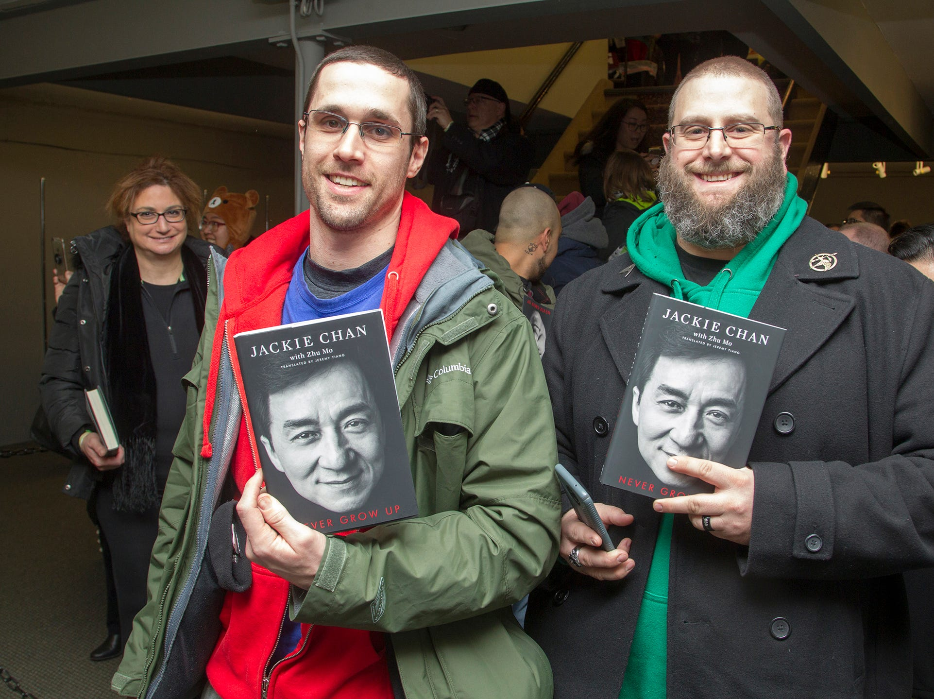 """Larry and Steven. Jackie Chan greets fans at Bookends in Ridgewood while signing his new book, """"Never Grow Up."""" 01/21/2019"""