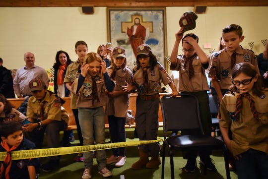 A group of scouts react as cars race to the finish line at the Morris County Pinewood Derby at Holy Trinity Lutheran Church in Rockaway on Friday January 18, 2019.