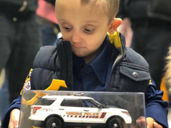 Micco LaRosa awes at his toy Verona police car Jan. 20, 2019.