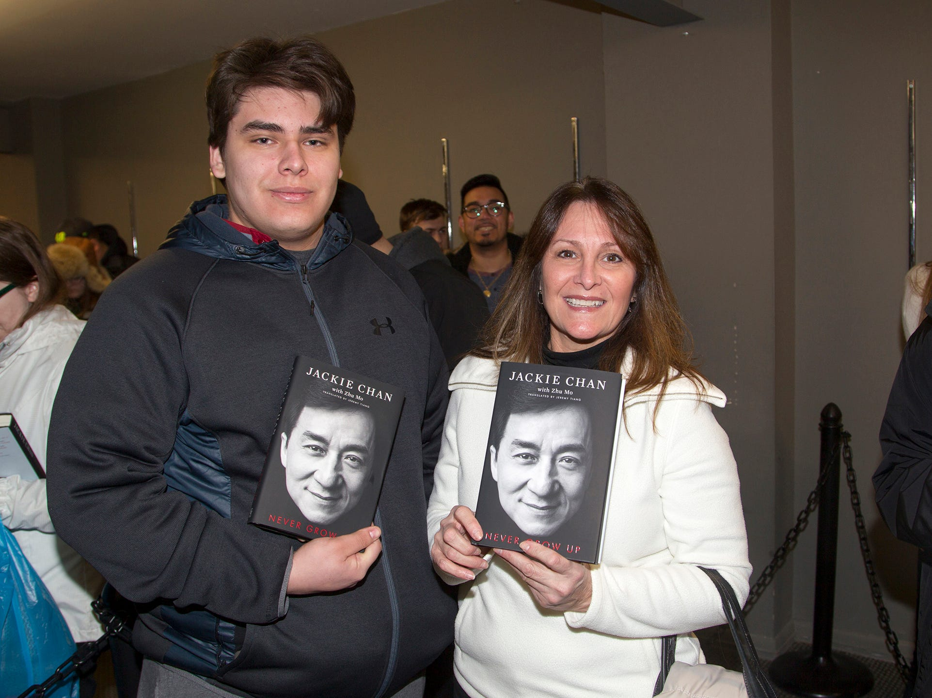 """Carl and Nancy. Jackie Chan greets fans at Bookends in Ridgewood while signing his new book, """"Never Grow Up."""" 01/21/2019"""