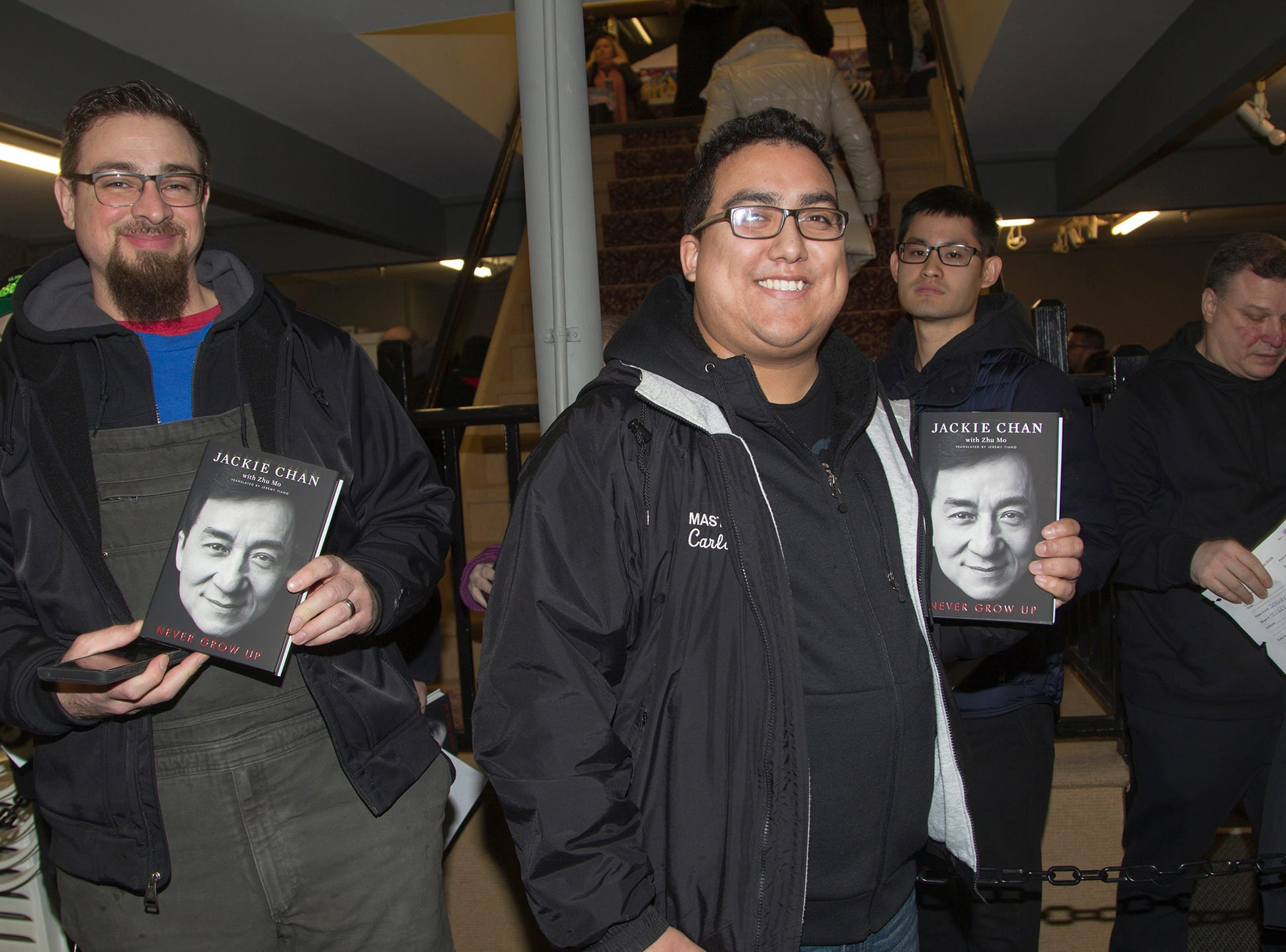 """John and Carlos. Jackie Chan greets fans at Bookends in Ridgewood while signing his new book, """"Never Grow Up."""" 01/21/2019"""