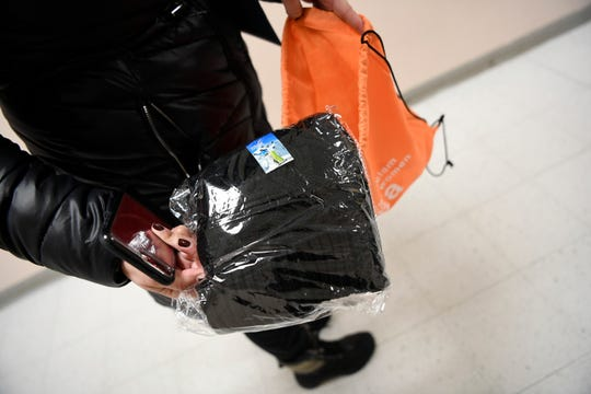 Volunteers for Bergen County's annual Point-in-Time count of the homeless carry supplies like thermals and blankets with them.