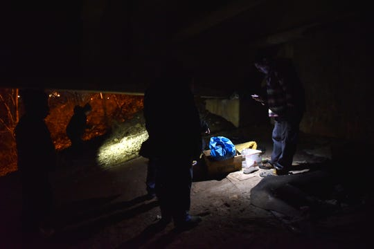 A group of Volunteers search under a Route 4 bridge for homeless people but find only their belongings in Hackensack, on Wednesday January 23, 2019.