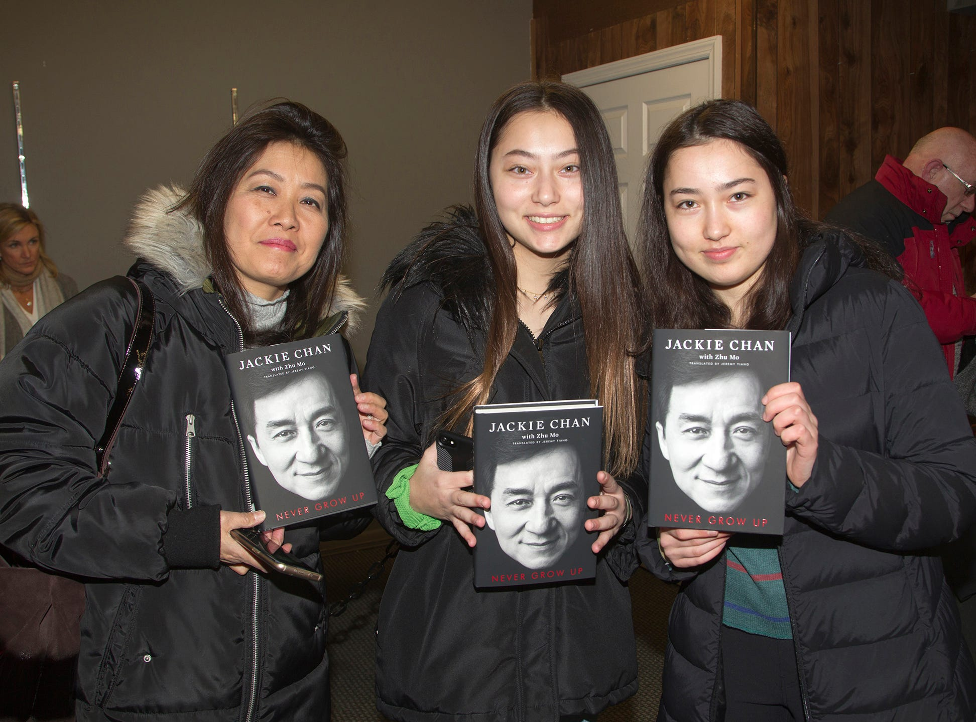 """Lisa, Becky, Karli. Jackie Chan greets fans at Bookends in Ridgewood while signing his new book, """"Never Grow Up."""" 01/21/2019"""
