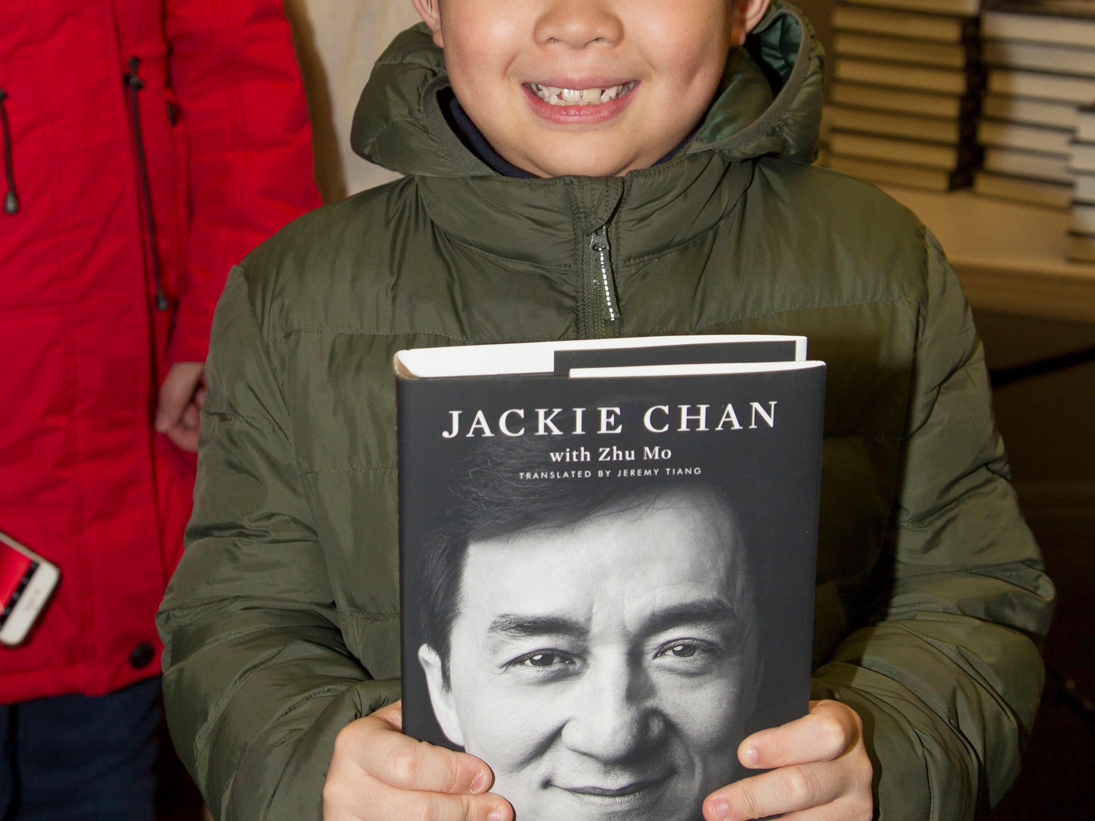 """Jonathan. Jackie Chan greets fans at Bookends in Ridgewood while signing his new book, """"Never Grow Up."""" 01/21/2019"""