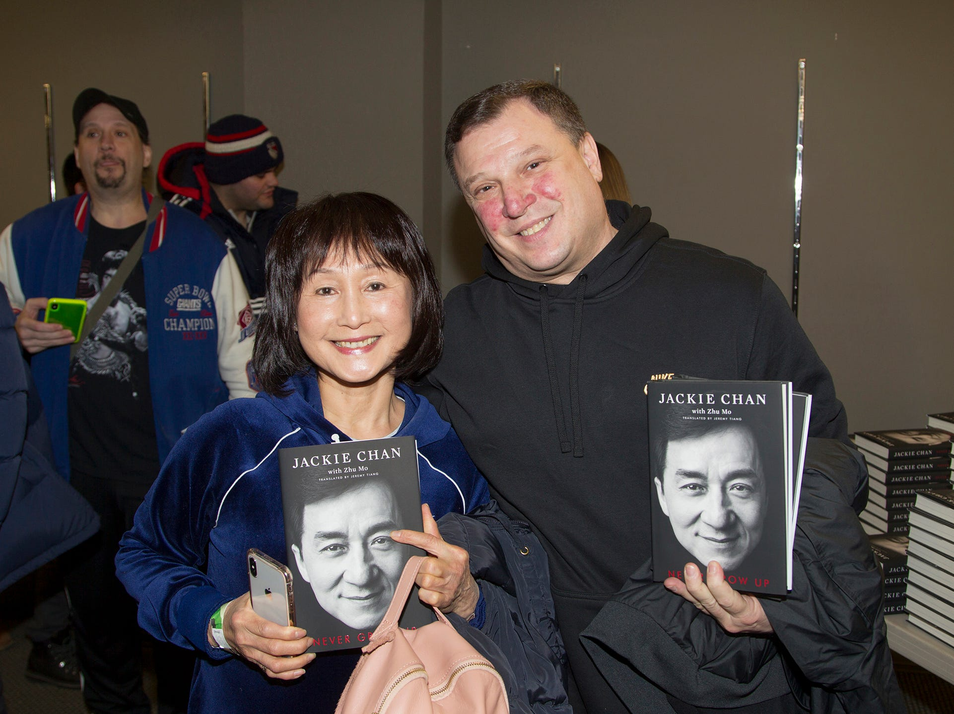 """Judy and Jake. Jackie Chan greets fans at Bookends in Ridgewood while signing his new book, """"Never Grow Up."""" 01/21/2019"""