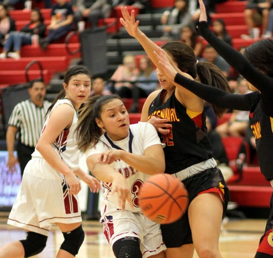 Freshman Lady 'Cat Harmanie Dominguez (3) found a congested key area during Tuesday's 51-37 loss to the visiting Centennial Hawks on Tuesday at Deming High.
