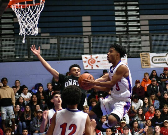 Las Cruces High's Marcus Scott goes up in the air for an easy layup during the Bulldawgs' 63-48 victory over the Oñate Knights on Tuesday, Jan. 22, 2019.