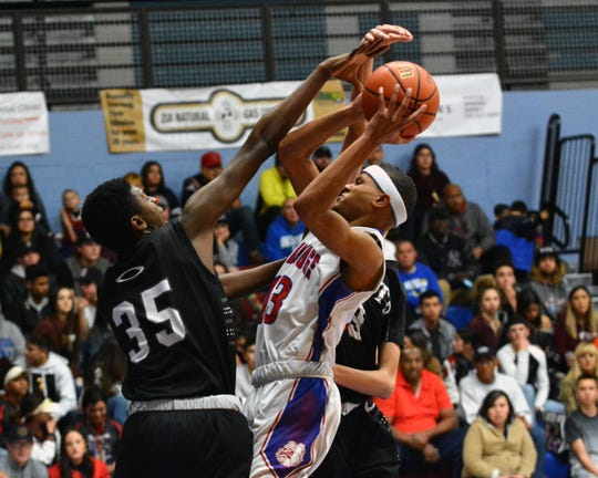 Las Cruces High's Ray Brown is challenged by Oñate's Damione Thomas Tuesday, Jan. 22, 2019. The Bulldawgs won 63-48 to improve to 18-0 on the year.