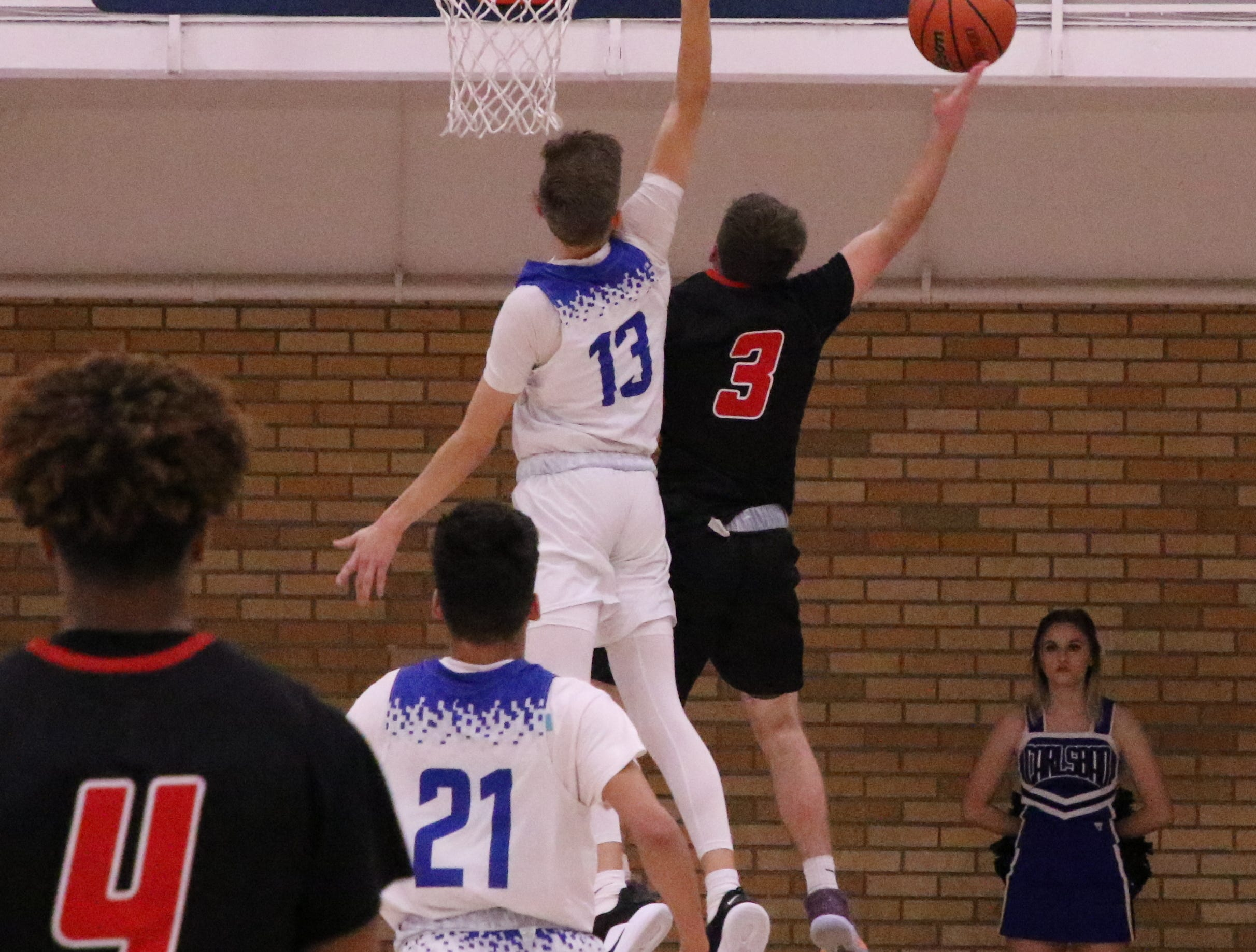 Carlsbad's Stevie Bartlett (13) goes for a block against Portales' Kellan Hightower (3) in the first half of Tuesday's game.