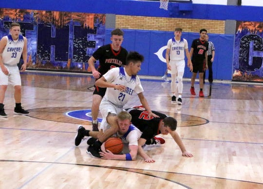 Carlsbad's Andrew Miller gets a loose ball secured from Portales' Julian Urioste in the second half of Tuesday's game.