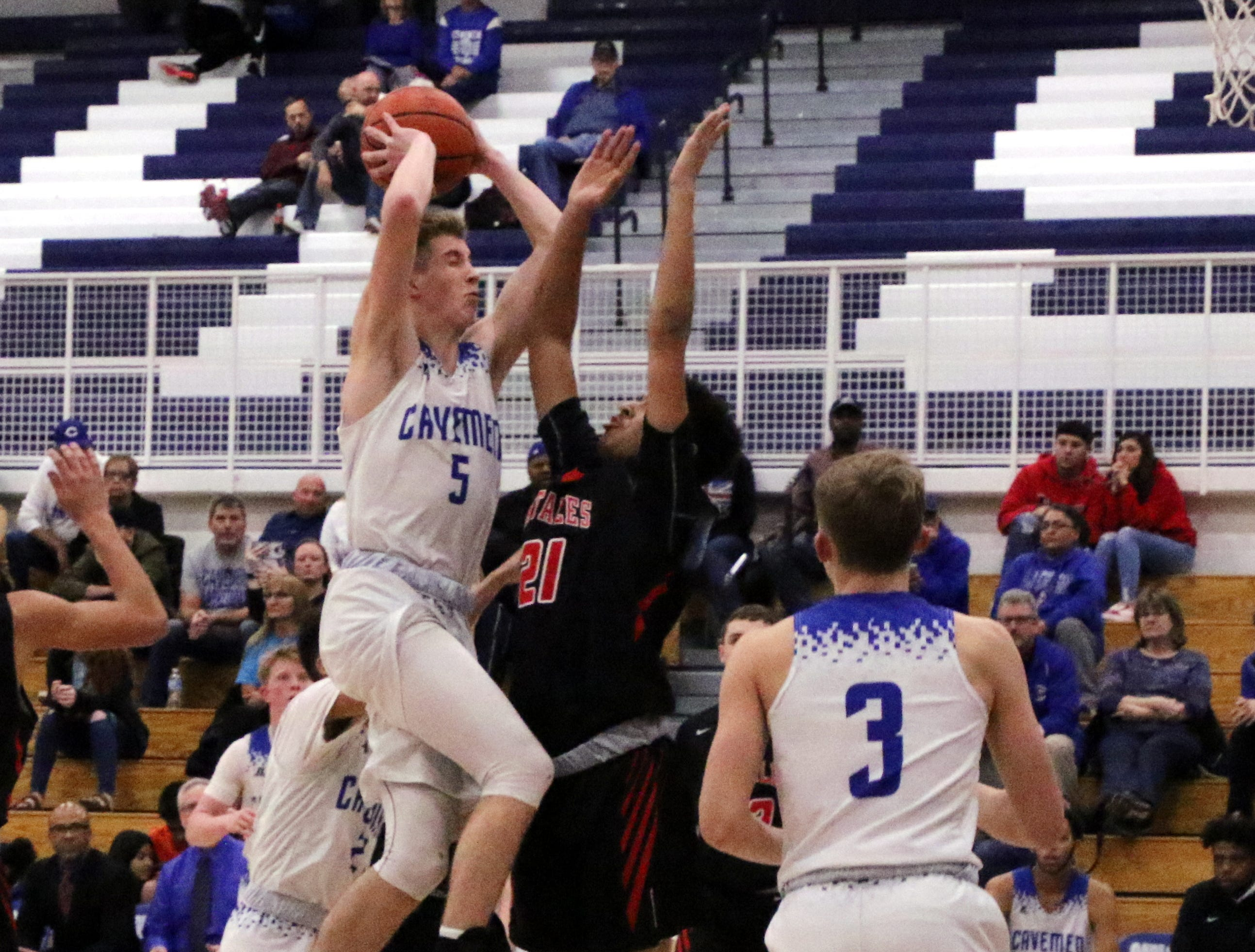 Evan Sullivan goes for a contested layup in the second half of Tuesday's game against Portales.