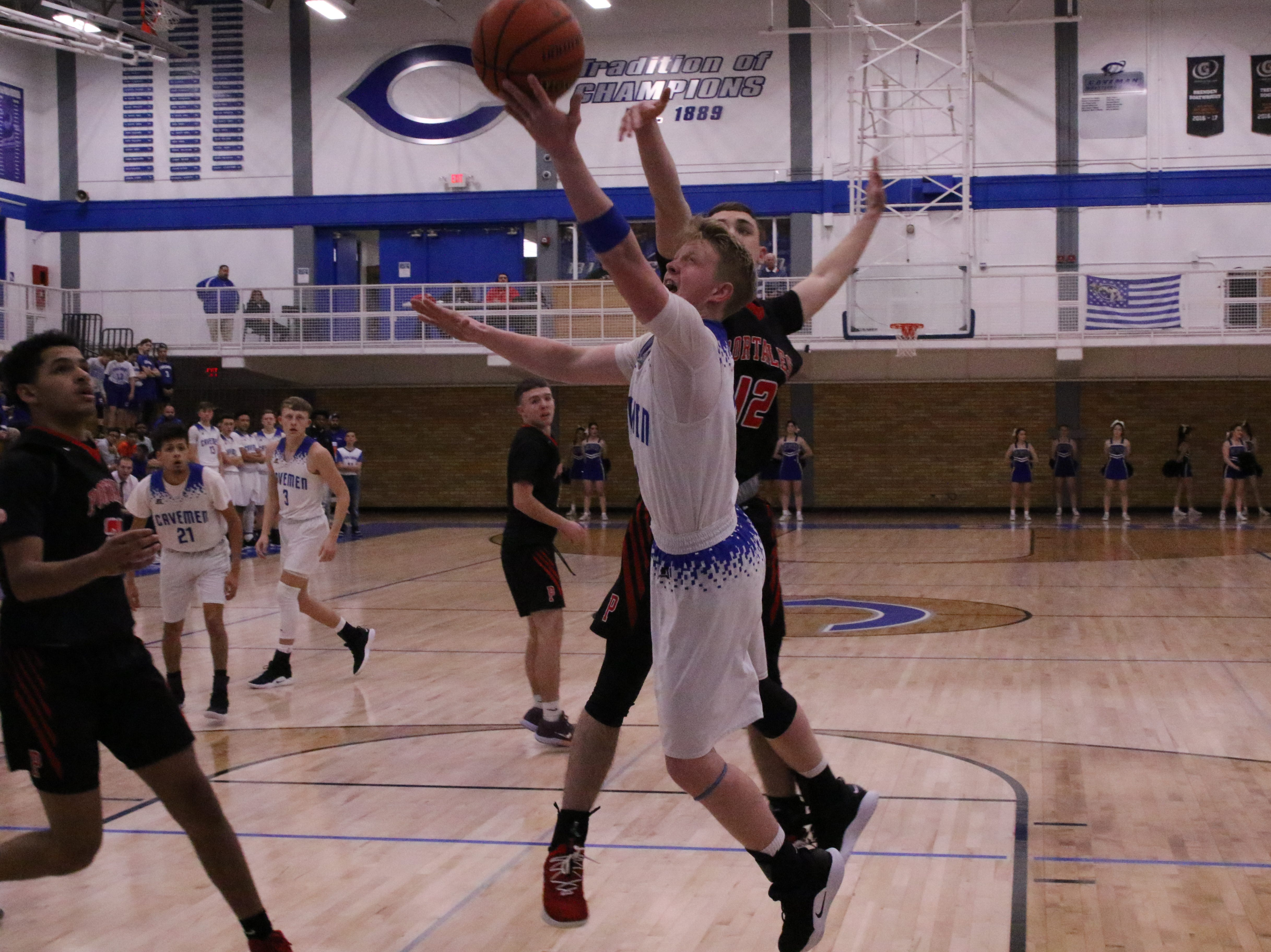 Carlsbad's Andrew Miller gets off a layup against Portales during the first half of Tuesday's game. Miller finished with 14 points.