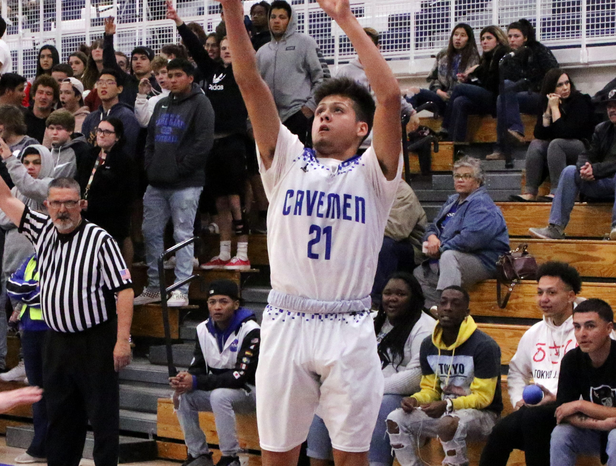 Carlsbad's Patrick Espinoza takes a 3-point shot in the first half of Tuesday's game against Portales.