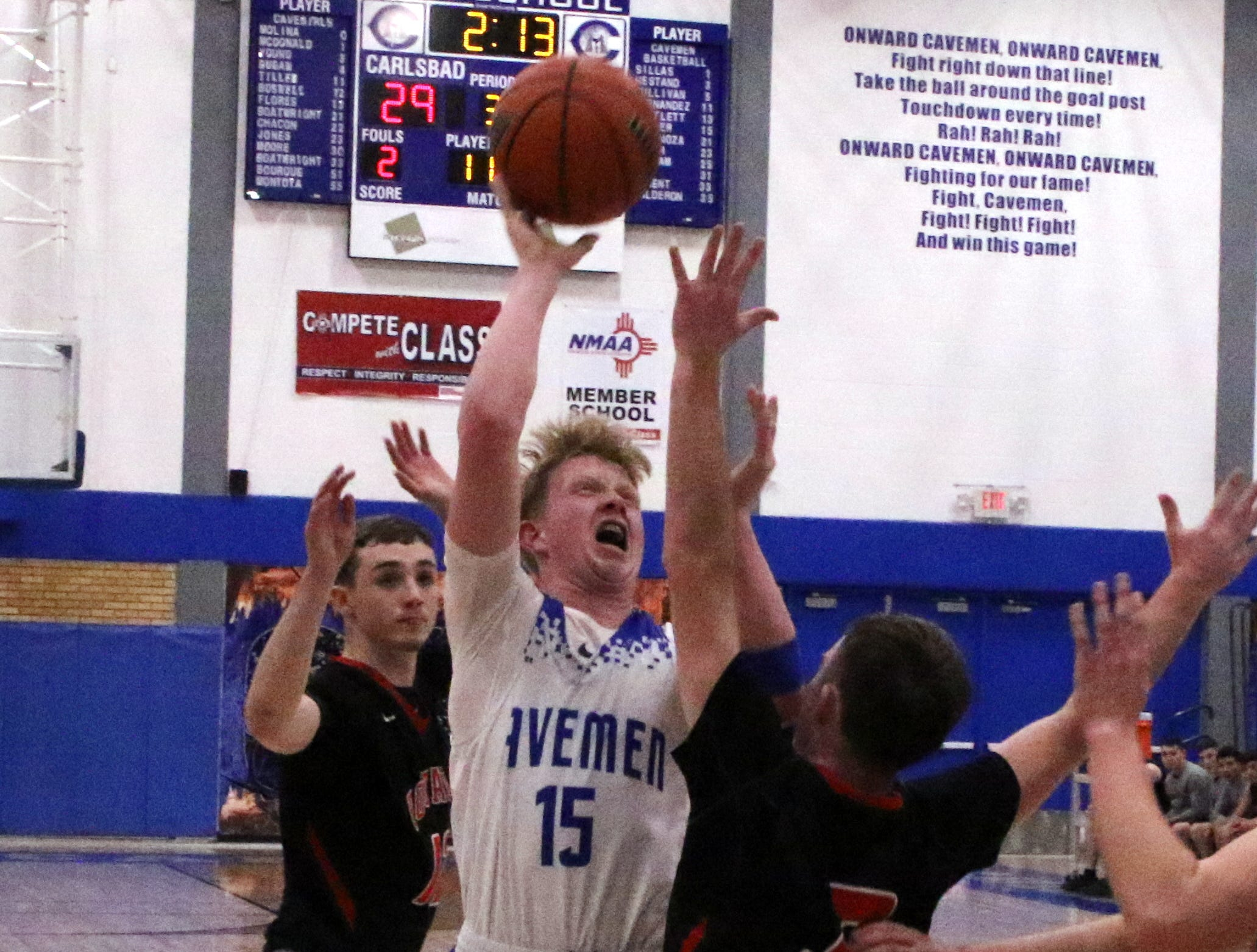 Carlsbad's Andrew Miller gets off a layup against Portales during the second half of Tuesday's game. Miller finished with 14 points.