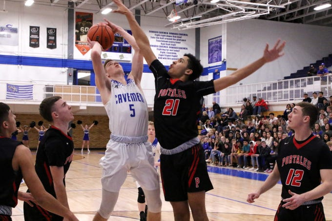 Carlsbad's Evan Sullivan tries to shoot over Portales' Master Taplin during Tuesday's game.
