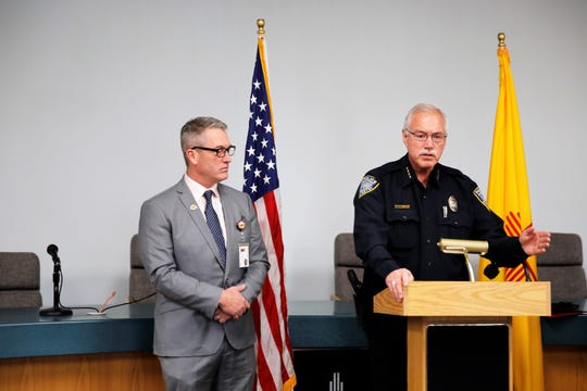 Aztec Mayor Victor Snover, left, listens as Aztec Police Chief Mike Heal talks about school safety Wednesday morning in Aztec Municipal School District board room.