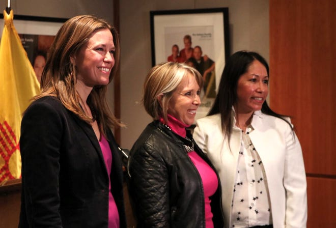 Lynn Trujillo, right, stands with Gov. Michelle Lujan Grisham, center, and Stephanie Schardin Clarke, left, on Tuesday in Santa Fe. Trujillo was appointed as secretary of Indian affairs and Schardin Clarke as secretary of taxation and revenue.