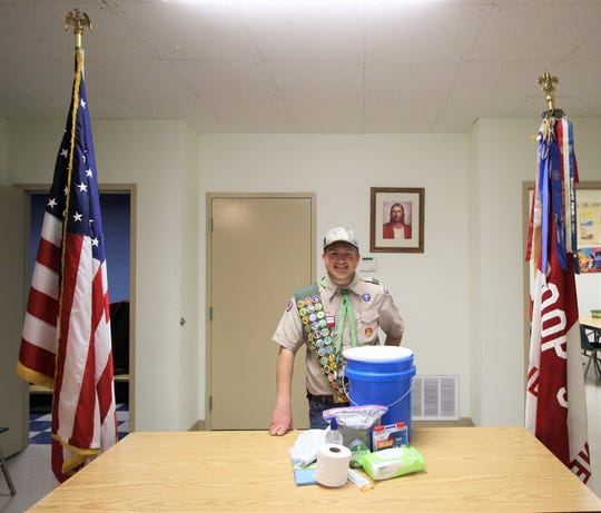 "Wesley Shaver stands next to his project to become an Eagle Scout. The ""Lock Down Buckets"" were distributed to 140 class rooms in Ruidoso this month."
