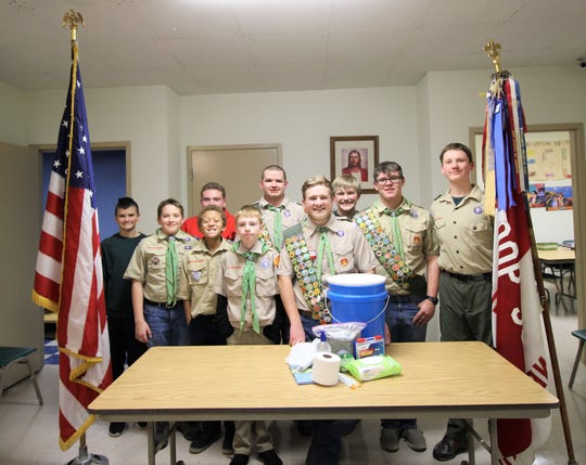 "Wesley Shaver (center) stands behind his Eagle Scout project ""Lock Down Buckets"" with Troop 59."