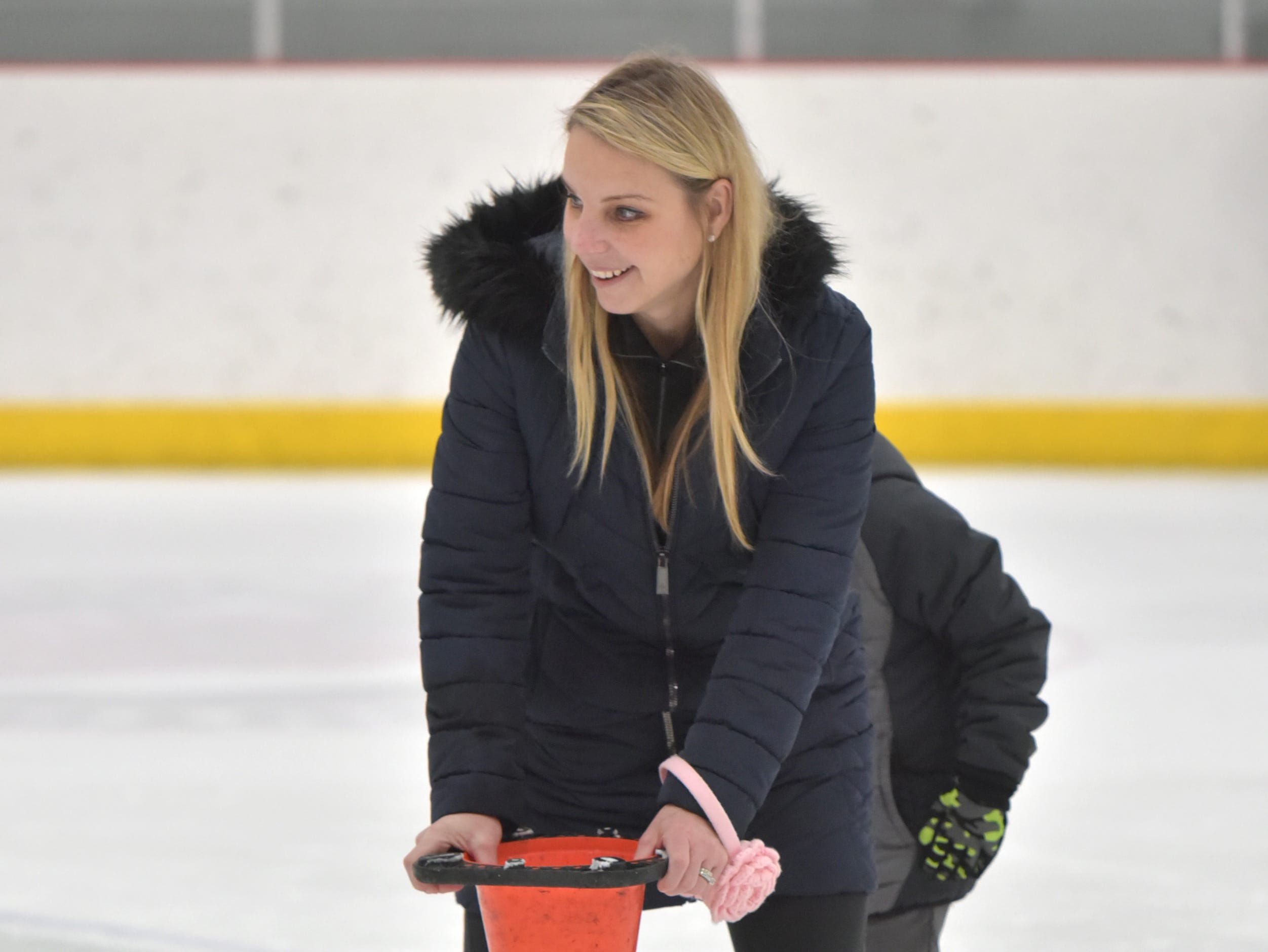 Trudy Talan has some fun at center ice during the Jan. 23 Noon Skate at the Novi Ice Arena. The Novi resident was at the rink with her kids Gia, 8, and Luca, 5.
