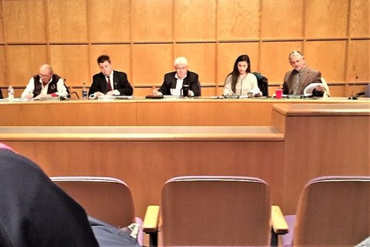 South Lyon City Council member Carl Richards (far left) violated the city's ethics ordinance when he made obscene remarks about colleague Mary Parisien (second from right) and looked in the windows of her home, an ethics board ruled Tuesday.