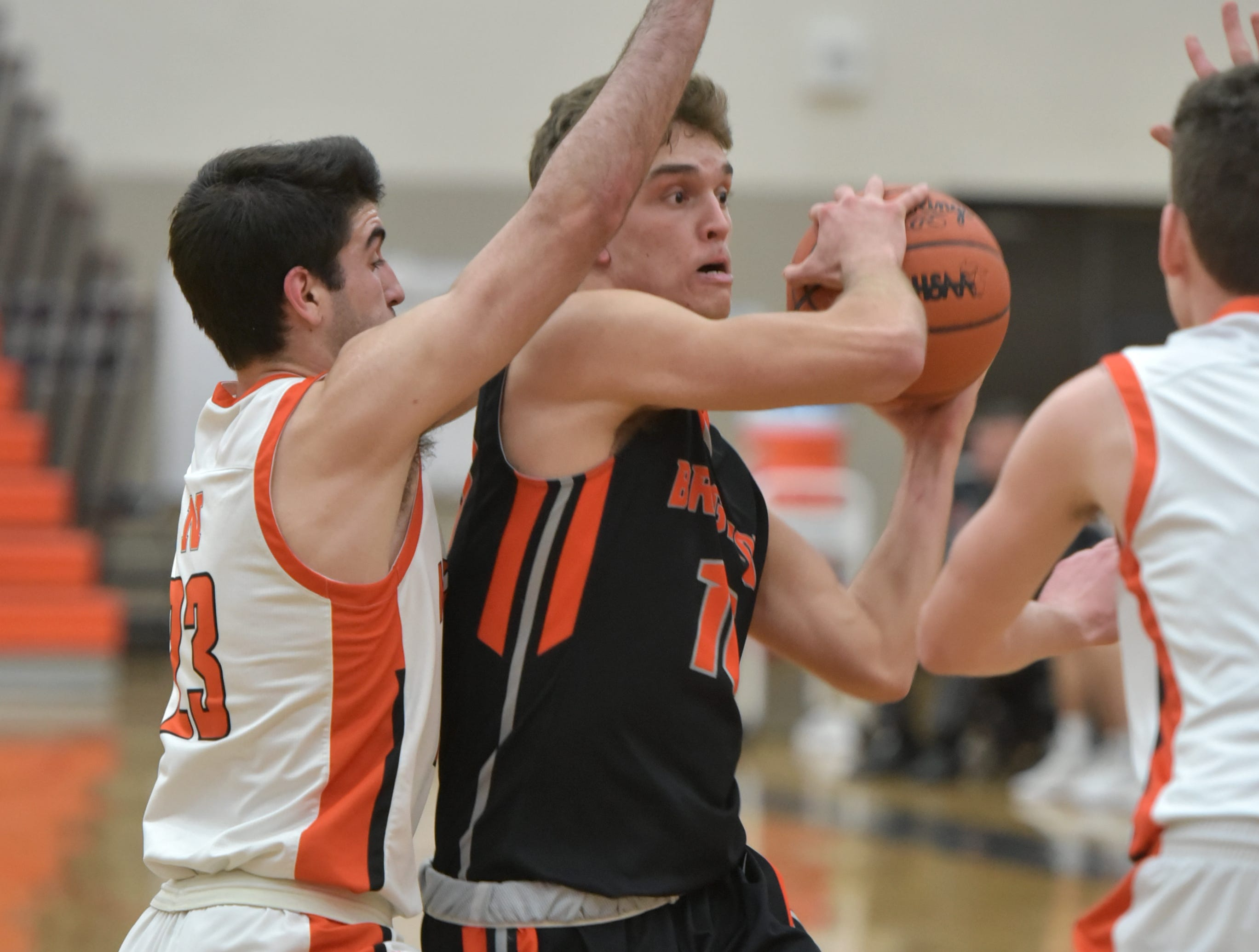 Brighton Bulldog Keenan Stolz looks to get rid of the ball as he surrounded by two Mustangs including Daniel McLaughlin, left.