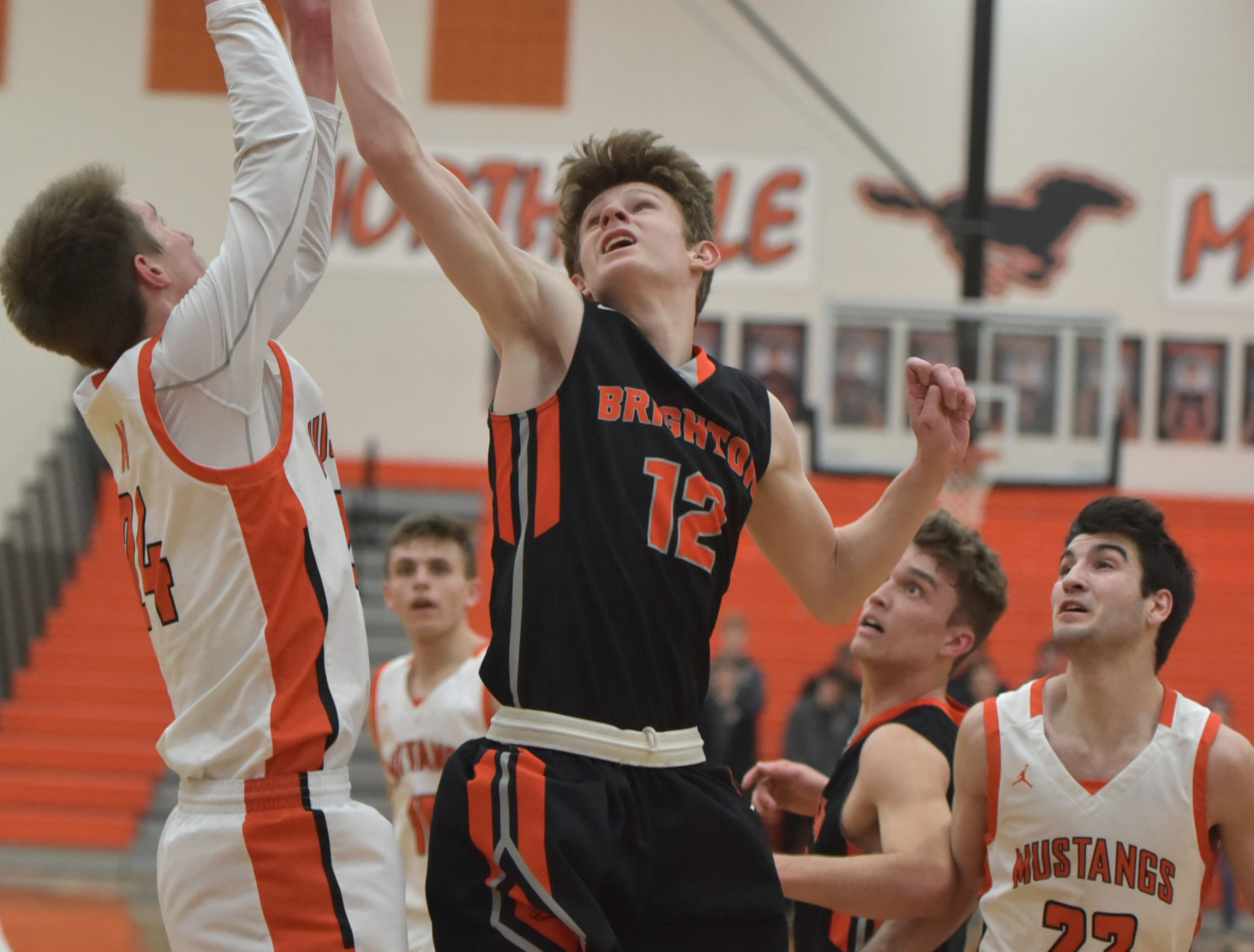 Brighton Bulldog Jacob Edwards, right, tries to tip a rebound out of the hands of Mustang Steven Morrissey.