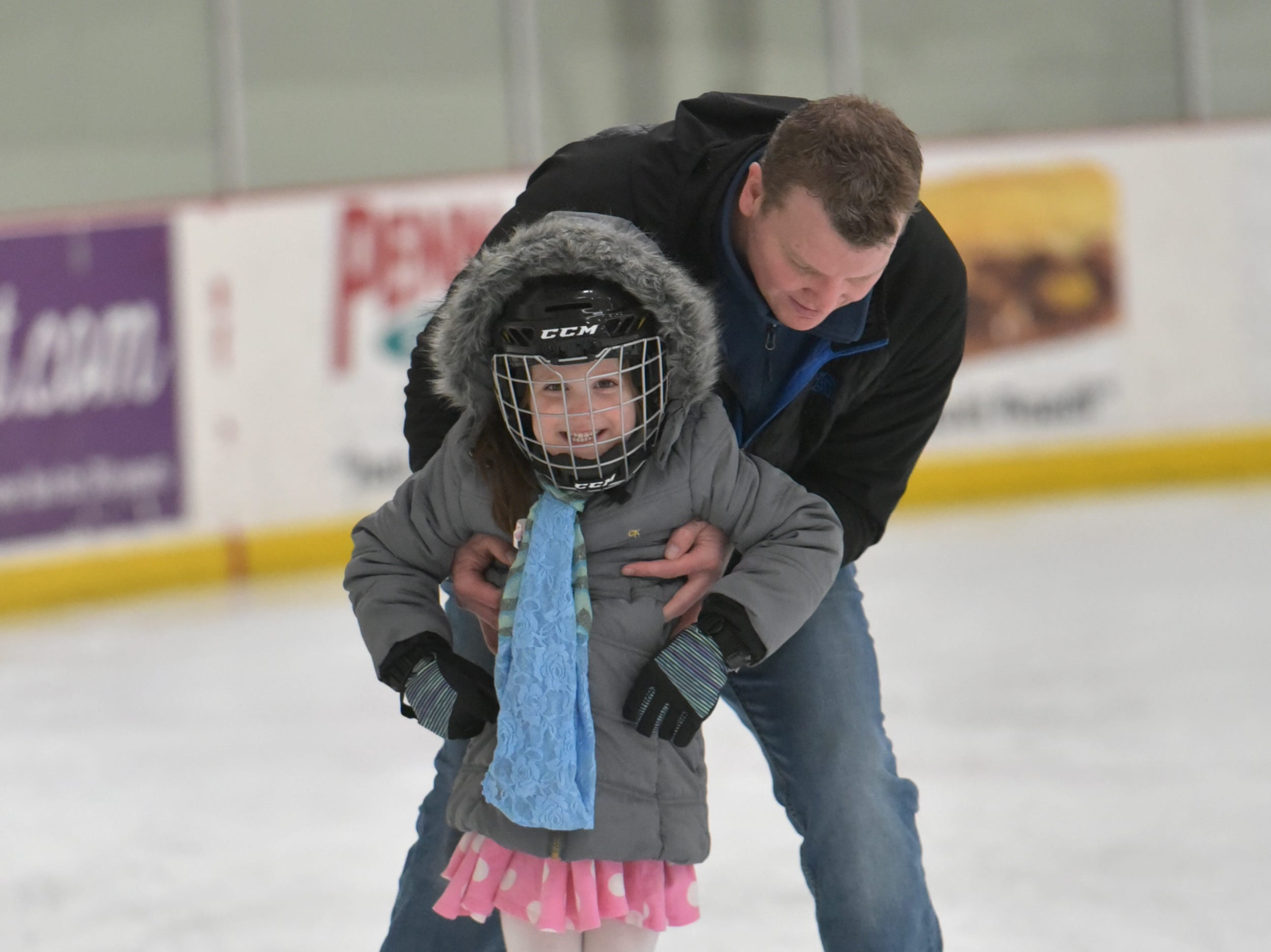 Shawn Dowling helps his daughter Edie, 4, across the surface at the Novi Ice Arena on Jan. 23 during its Noon Skate. The open-to-the-public skate takes place weekdays starting at 12 pm.