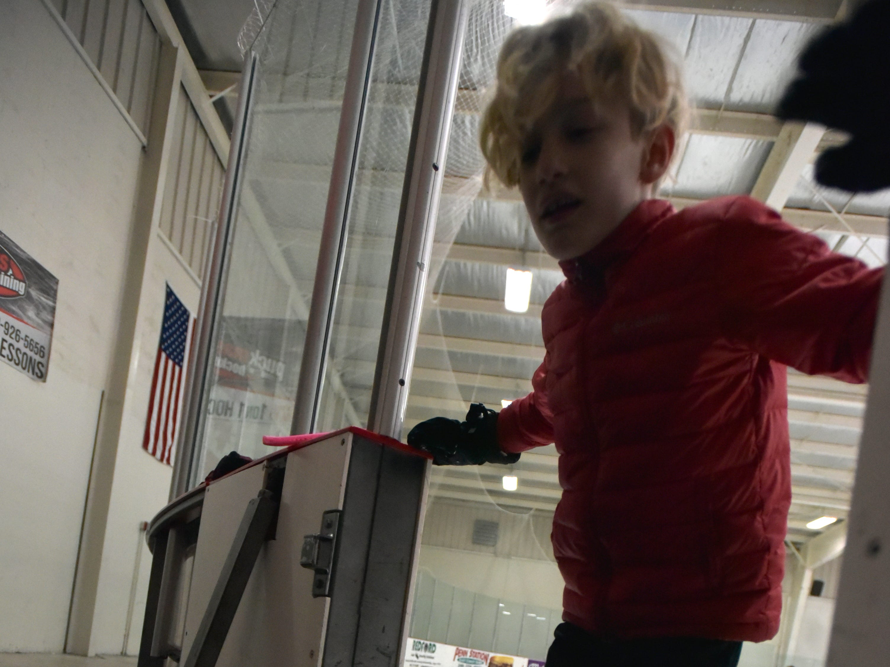 A skater comes off the ice in the Red Rink at the Novi Ice Arena.