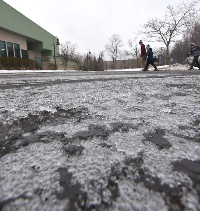 On Jan. 23 when most of the outside world resembled a skating rink, or this parking lot, visitors to the Novi Ice Arena head inside to its... skating rink - for its weekday Noon Skate. The noon-1:50 p.m. skate costs $3, skate rentals are $3 and the rink is located at 42400 Nick Lidstrom DriveNovi, MI  48375. Their phone number is 248-347-1010.