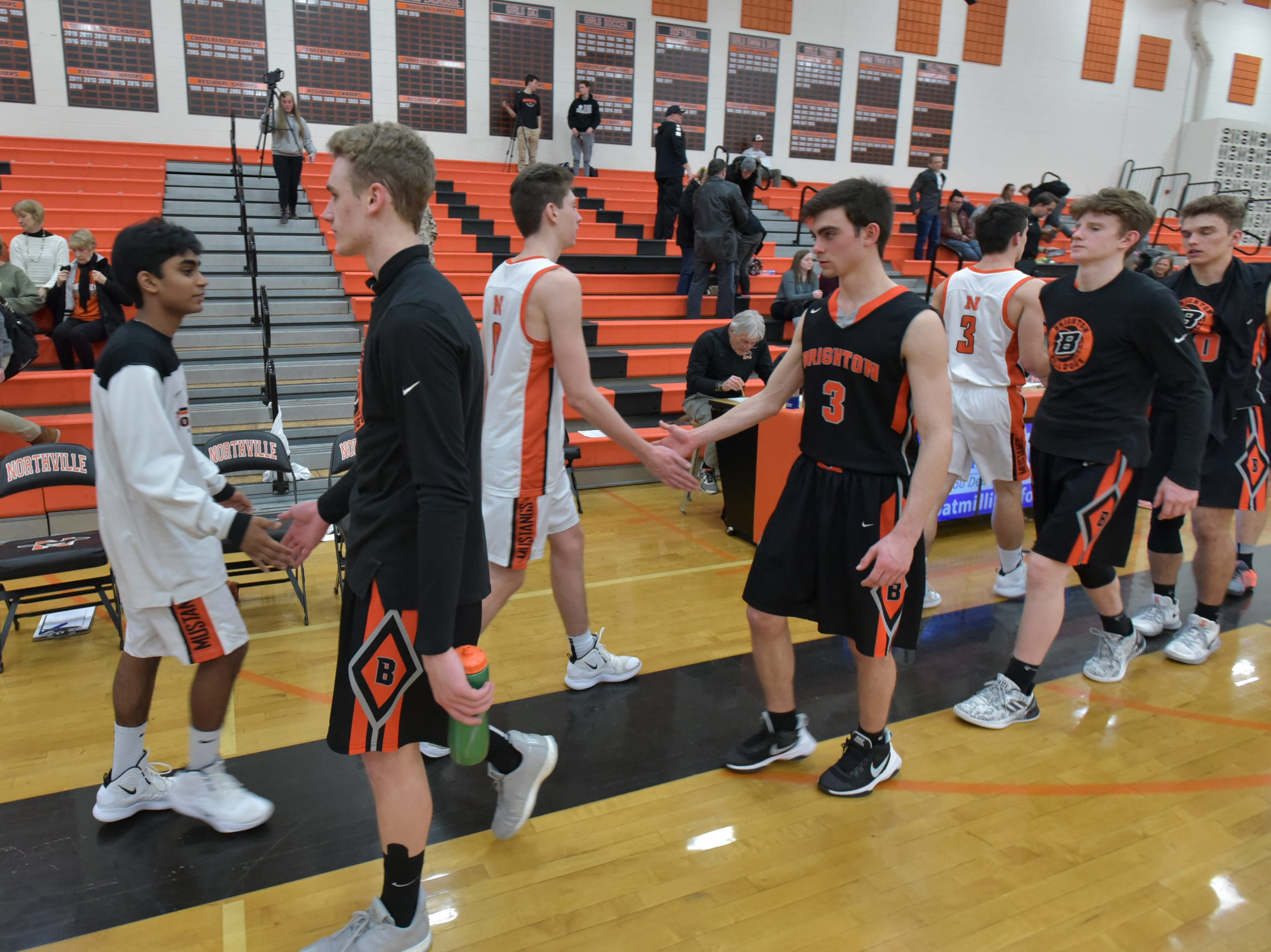 The two teams greet each other after their Jan. 20 game at Northville High.
