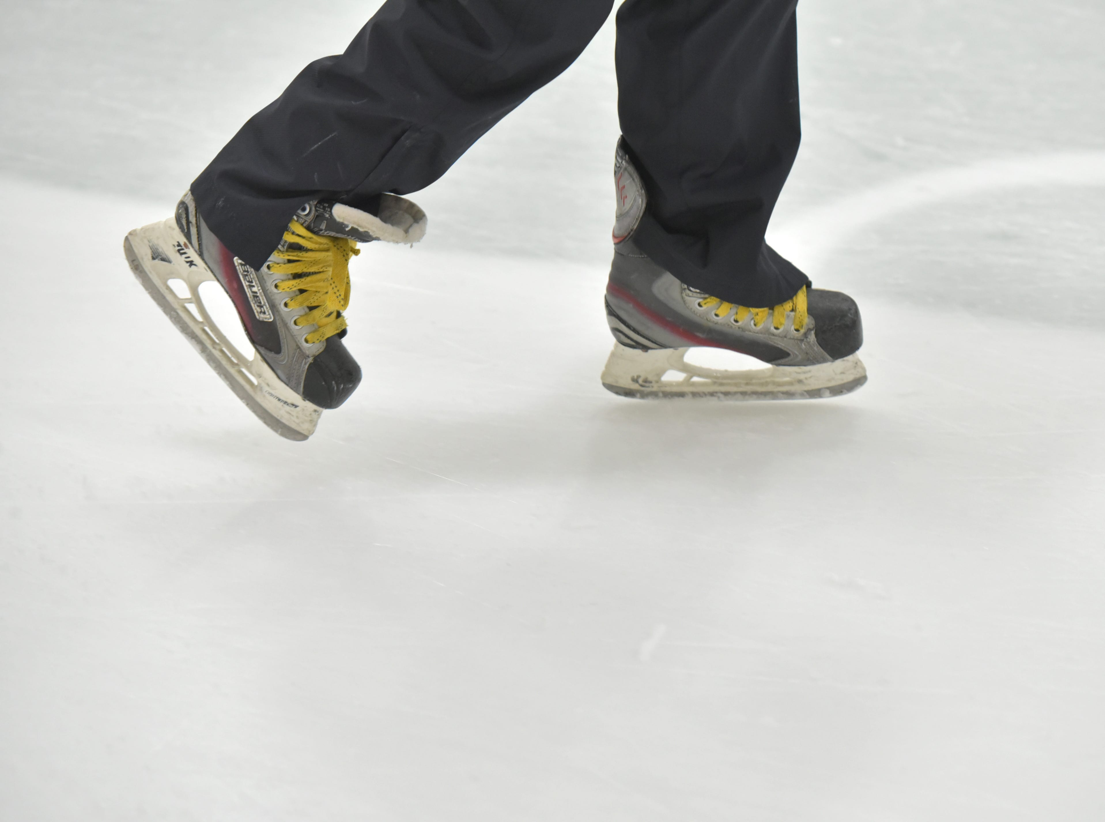 A young skater glides along the ice at the Novi Ice Arena.