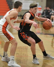 Brighton's Jacob Dunn (right) backs down a Northville defender in a KLAA West Division game on Jan. 22.