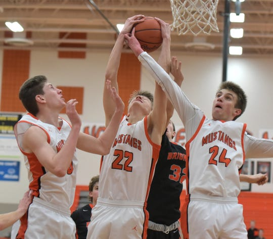 Northville players (from left) Zach Shoemacher, Ryan Pumper and Steven Morrissey get inside position for the rebound over Brighton's Owen Ehman.