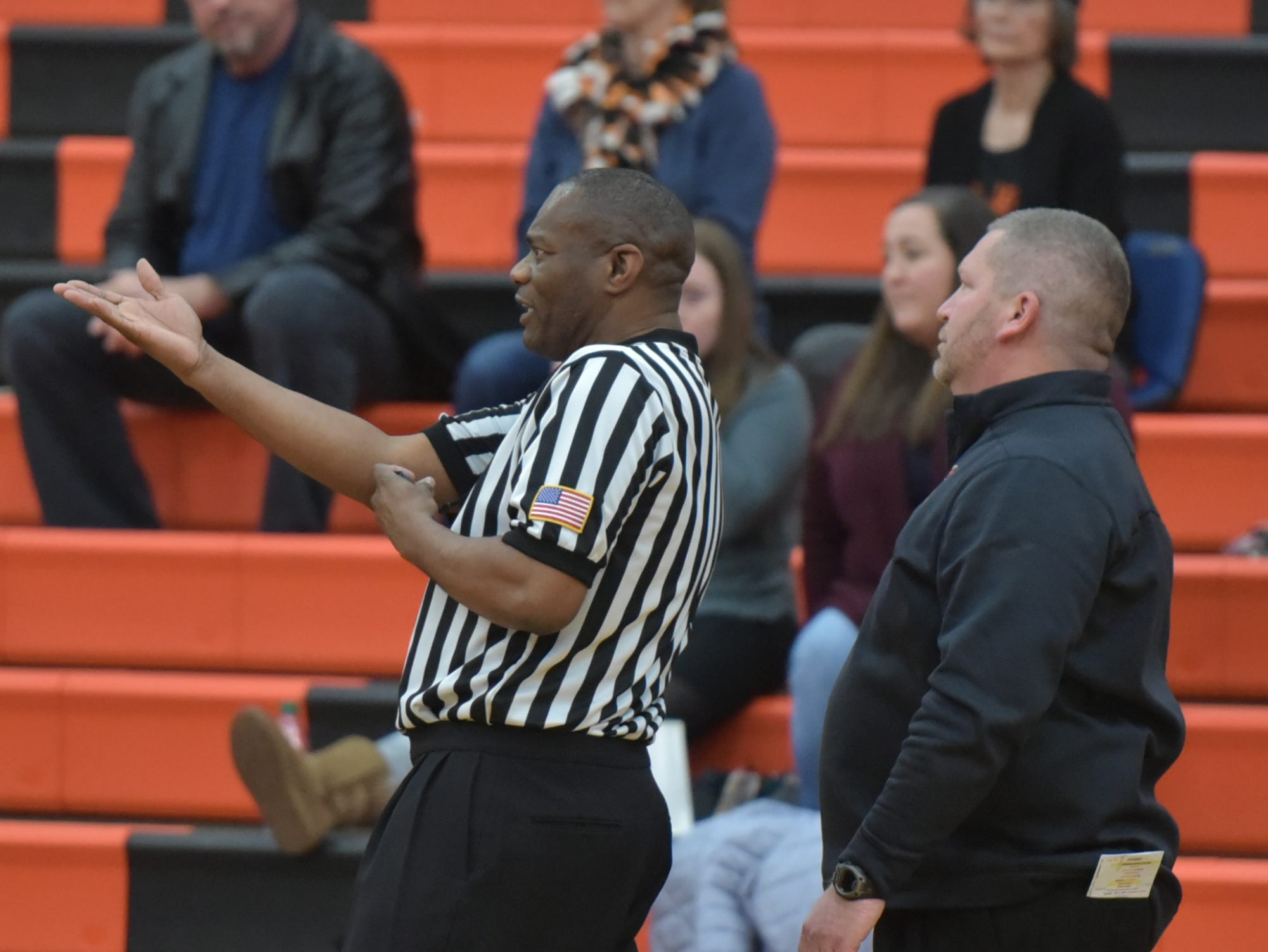 Brighton head coach Mike Griest, right, gets an explanation from a referee as to why a charge wasn't called on a Northville player during the game.