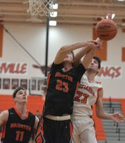 Northville's Daniel McLaughlin (right) slaps a rebound out of the hands of Brighton's Noah Bennett.