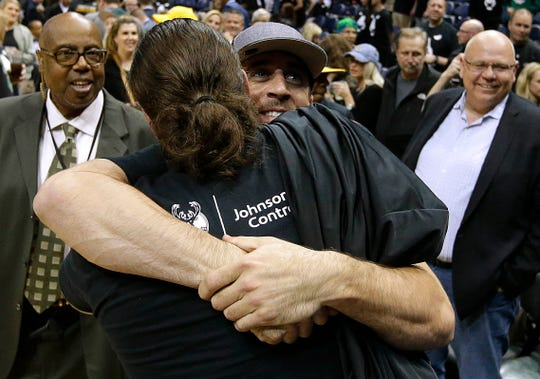 Packers quarterback Aaron Rodgers gives teammate David Bakhtiari a hug after the Bucks defeat the Toronto Raptors in Game 3 of the first round in the 2017 playoffs.