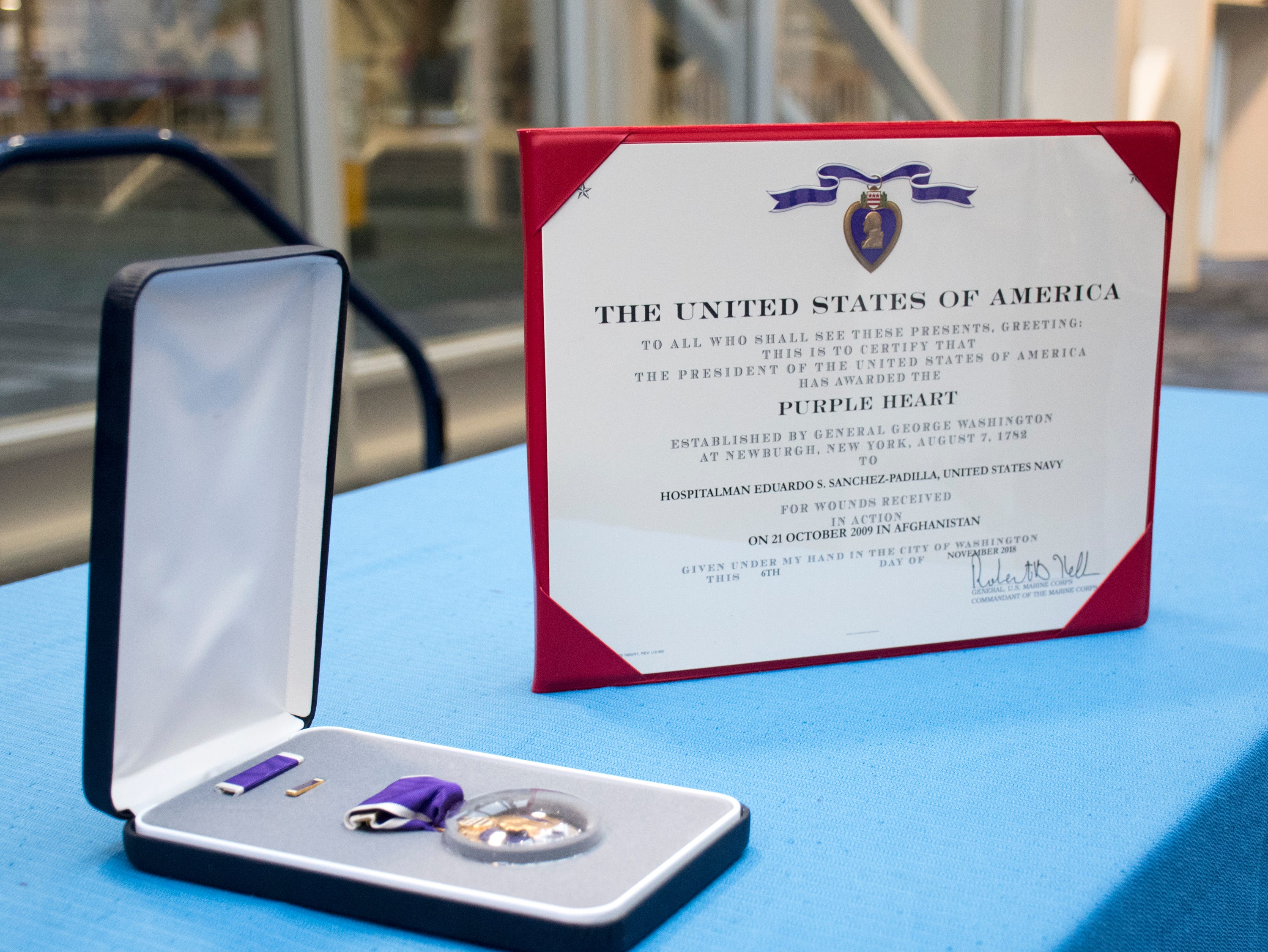 Navy Hospital Corpsman 1st Class Eduardo Sanchez-Padilla was awarded the Purple Heart during a ceremony at the National Naval Aviation Museum in Pensacola on Wednesday, January 23, 2019.  Sanchez-Padilla was wounded in Afghanistan in 2009.