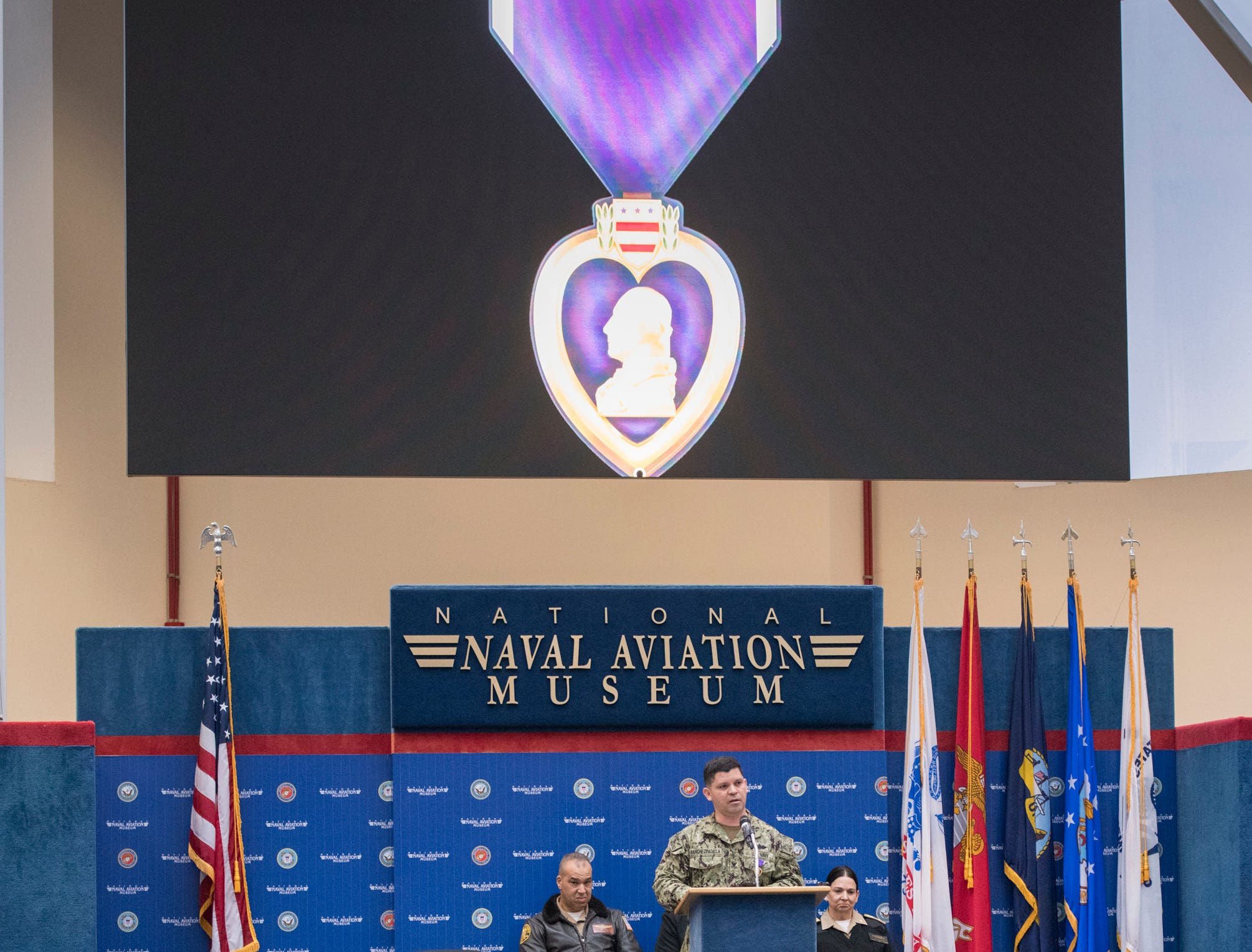 Navy Hospital Corpsman 1st Class Eduardo Sanchez-Padilla speaks after receiving the Purple Heart during a ceremony at the National Naval Aviation Museum in Pensacola on Wednesday, January 23, 2019.  Sanchez-Padilla was wounded in Afghanistan in 2009.
