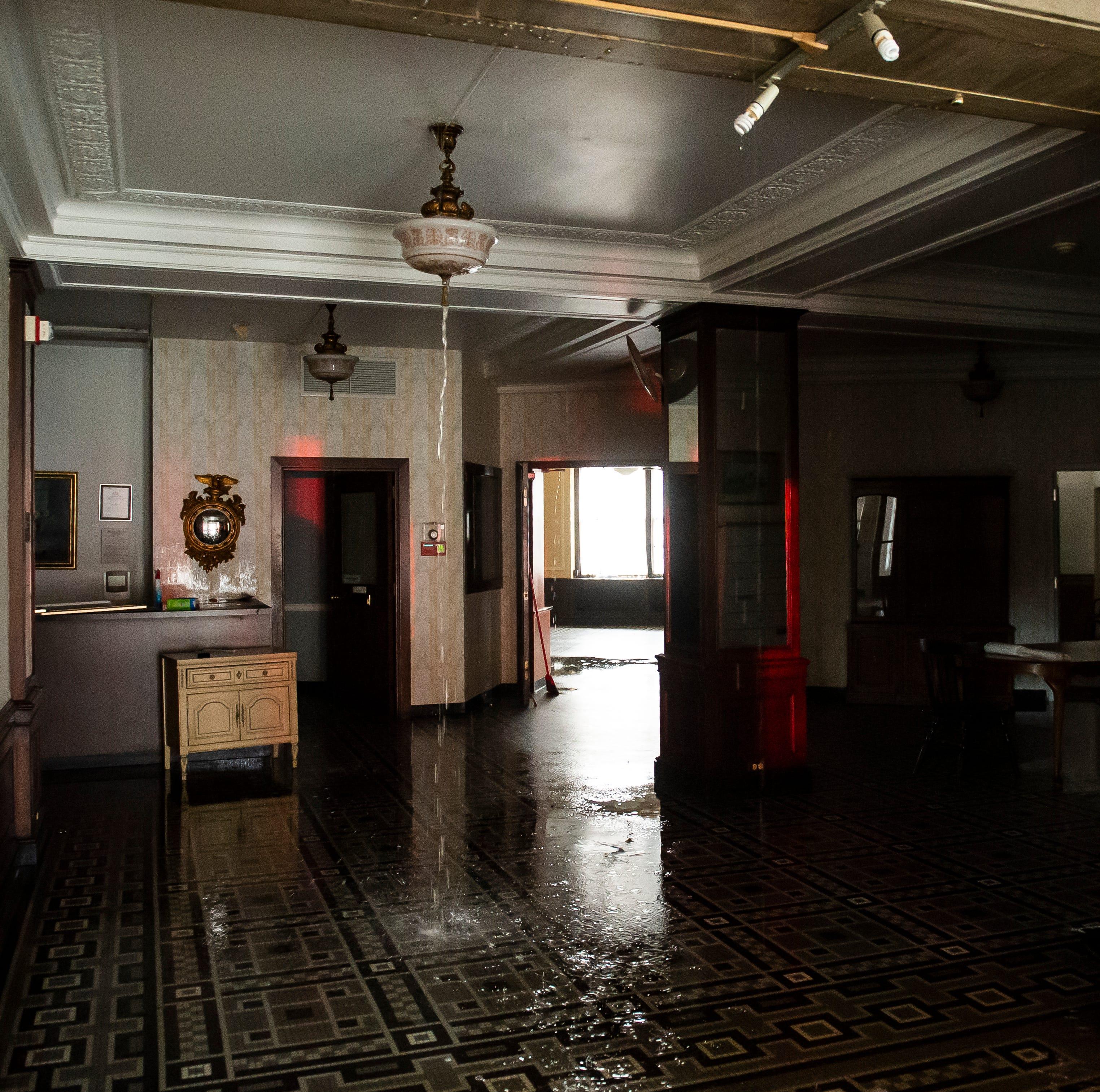 Frozen sprinkler pipe bursts in vacant M'Calister Inn