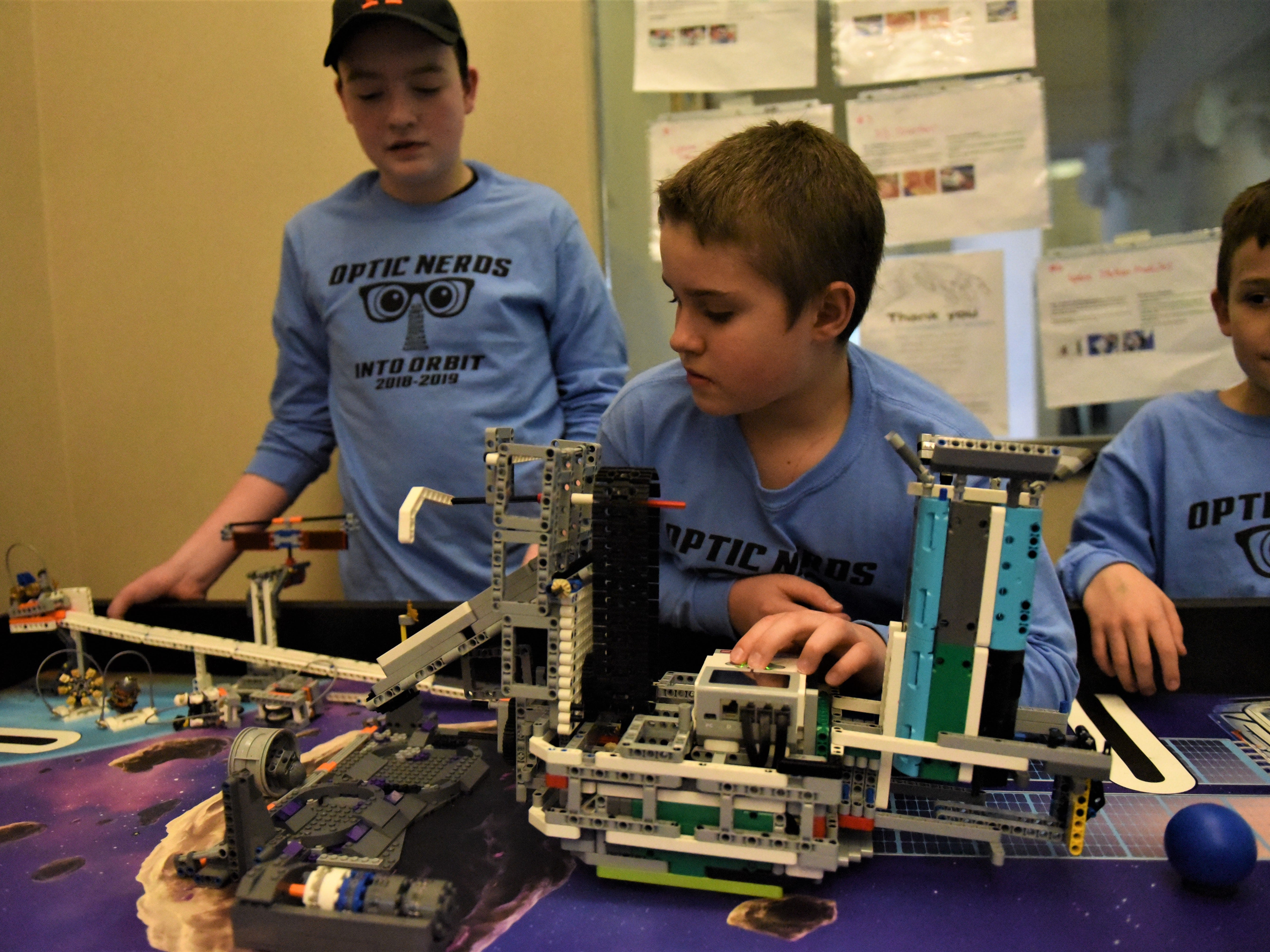 Joseph McCall, 11, tests a robot with his teammates on the Optic Nerds, a robotics team. The team will compete at the FIRST LEGO League Challenge on Jan. 26, and the theme is Into Orbit.